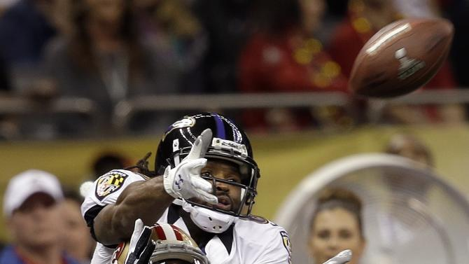 San Francisco 49ers defensive back Chris Culliver (29) breaks up a pass intended for Baltimore Ravens wide receiver Torrey Smith, top, during the first half of the NFL Super Bowl XLVII football game, Sunday, Feb. 3, 2013, in New Orleans. (AP Photo/Elaine Thompson)