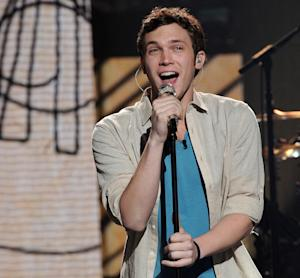 """FILE - In this April 25, 2012 file photo released by Fox, contestant Phillip Phillips performs on the singing competition series """"American Idol,"""" in Los Angeles. The """"American Idol"""" winner will be announced May 23, 2012. (AP Photo/Fox, Michael Becker, File)"""