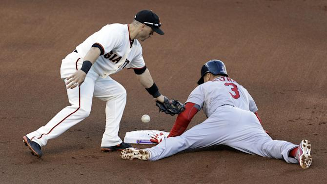 St. Louis Cardinals' Carlos Beltran steals second with San Francisco Giants' Marco Scutaro covering during the first inning of Game 7 of baseball's National League championship series Monday, Oct. 22, 2012, in San Francisco. (AP Photo/Eric Risberg)