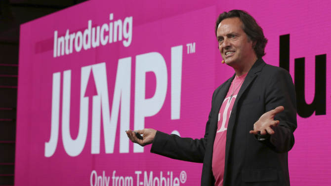 In this Wednesday, July 10, 2013, photo, T-Mobile CEO John Legere speaks during news conference in New York. T-Mobile says it will let people upgrade phones more quickly for a $10 monthly fee. With the new Jump plan, a customer will be able to get a new phone if the old one malfunctions or gets lost, or even if there's a better phone that comes out. The plan lets customers upgrade up to twice a year. Rivals typically allow upgrades after about two years. (AP Photo/Mary Altaffer)