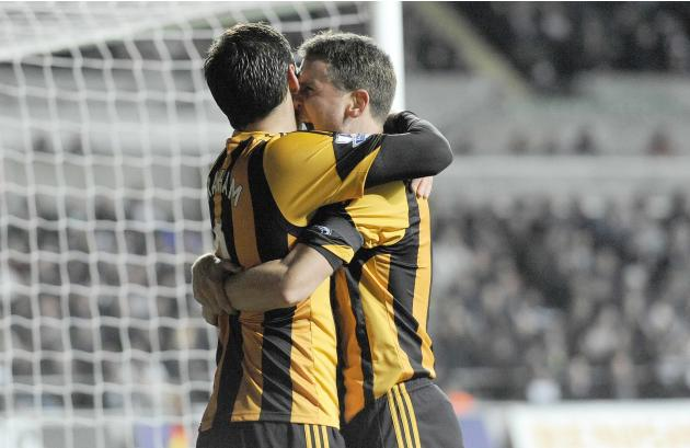 Hull City's Danny Graham celebrates with teammate Alex Bruce after scoring a goal against Swansea City during their English Premier League soccer match at the Liberty Stadium in Swansea