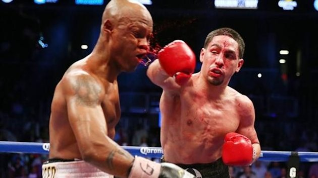 NEW YORK, NY - APRIL 27: Danny Garcia punches Zab Judah during the WBA Super and WBC Super Lightweight title fight at Barclays Center on April 27, 2013 in the Brooklyn borough of New York City.Garcia was declared the winner after 12 rounds. (Getty)