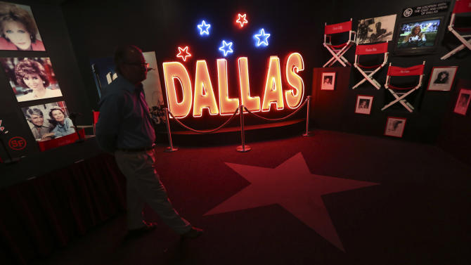 """In this photo made Tuesday, Nov. 13, 2012, a tourist looks at the Dallas TV show museum at Southfork Ranch in Parker, Texas. Tourists have been flocking to Southfork Ranch since the early years of the classic series, which ran from 1978 to 1991. And a new """"Dallas"""" starting its second season on TNT on Monday and the recent death of the show's star, Larry Hagman, who legendarily played conniving Texas oilman J.R. Ewing, have also spurred fans to visit. (AP Photo/LM Otero)"""