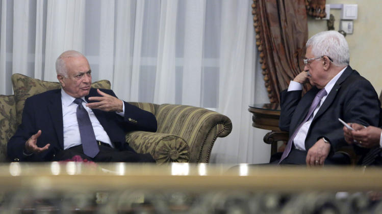 Palestinian President Mahmoud Abbas listens to Arab League Secretary General Nabil Elaraby, left, during their meeting at his residence in Cairo, Egypt, Saturday, Aug. 23, 2014. Talks focused on the ongoing Israeli-Palestinian conflict in Gaza. (AP Photo/Amr Nabil)