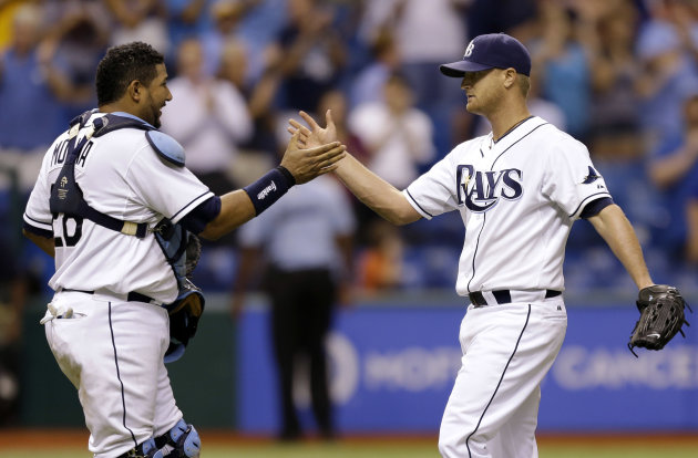 Tampa Bay Rays catcher Jose Molina, left, congratulates starting pitcher Alex Cobb after the Rays shut out the Oakland Athletics 5-0 during a baseball game Thursday, Aug. 23, 2012, in St. Petersburg,