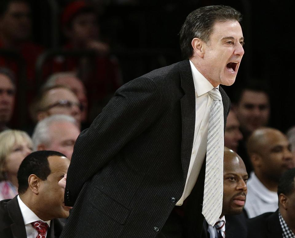 Louisville head coach Rick Pitino calls out to his team during the first half of an NCAA college basketball game against Villanova at the Big East Conference tournament, Thursday, March 14, 2013, in New York. (AP Photo/Frank Franklin II)