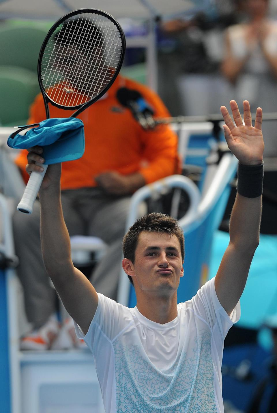 Australia's Bernard Tomic celebrates after defeating Germany's Daniel Brands in their second round match at the Australian Open tennis championship in Melbourne, Australia, Thursday, Jan. 17, 2013. (AP Photo/Andrew Brownbill)