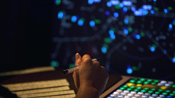 FILE - This April 18, 2011 file-pool photo shows an air traffic controller working in a terminal radar approach control room at the Atlanta TRACON in Peachtree City, Ga. Airlines and the nation's largest pilots' union are joining forces to sue the Federal Aviation Administration (FAA) over its decision to furlough air traffic controllers as the result of automatic, across-the-board spending cuts required by Congress. (AP Photo/David Goldman, File-Pool)