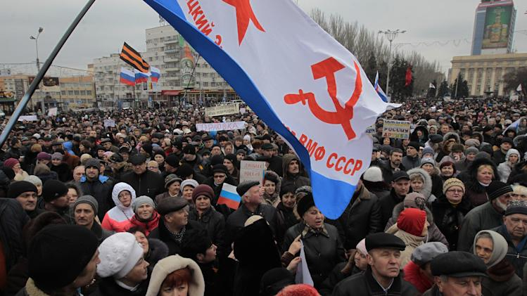 People shout slogans during a pro Russian rally at a central square in Donetsk, Ukraine, Sunday, March 9, 2014. (AP Photo/Sergei Chuzavkov)