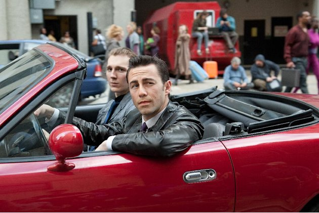 This film image released by Sony Pictures shows Joseph Gordon-Levitt, foreground, and Paul Dano in a scene from the action thriller &quot;Looper.&quot; (AP Photo/Sony Pictures Entertainment, Alan Markfield)