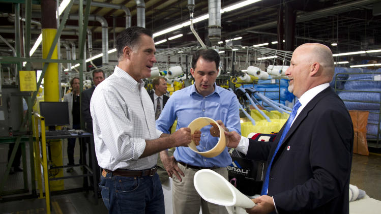 President of Montery Mills, Dan Sinykin, right, gives a tour to Republican presidential candidate, former Massachusetts Gov. Mitt Romney, left, and Gov. Scott Walker, R-Wis., during a campaign stop on Monday, June 18, 2012 in Janesville, Wis.  (AP Photo/Evan Vucci)
