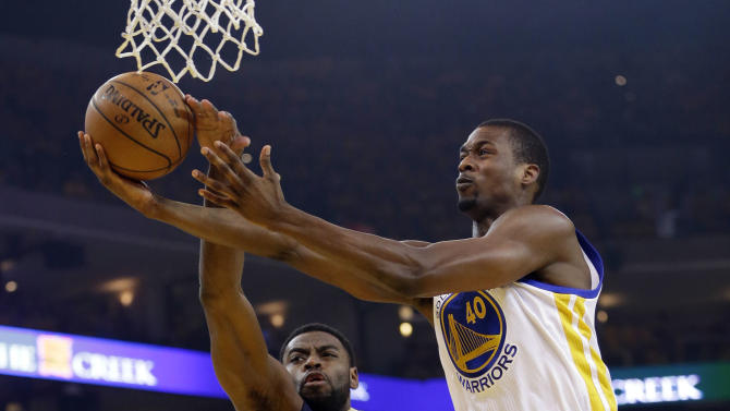Golden State Warriors' Harrison Barnes (40) has his shot blocked by New Orleans Pelicans' Tyreke Evans (1) during the first half in Game 2 of a first-round NBA basketball playoff series Monday, April 20, 2015, in Oakland, Calif. (AP Photo/Marcio Jose Sanchez)