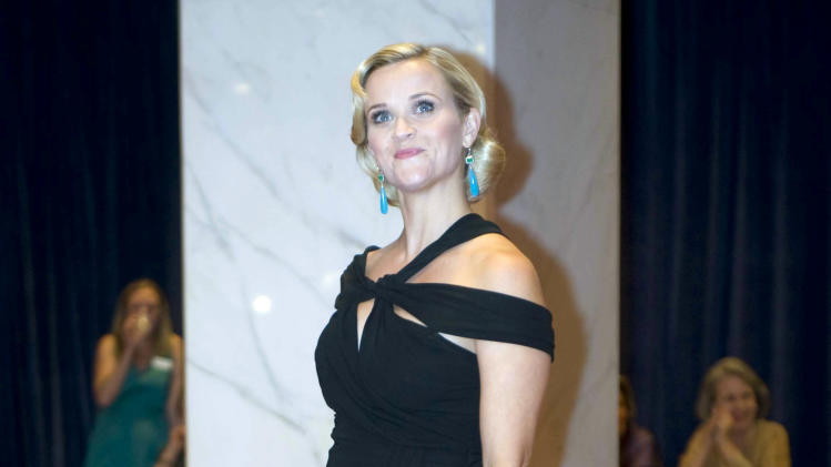 "FILE - In this April 28, 2012, file photo, Reese Witherspoon arrives at the White House Correspondents Association dinner in Washington. It will be Sarah Jessica Parker's house, but President Barack Obama's show. You could call it ""Checks and the City."" Needing to boost his donor base and campaign cash, Obama is banking on elite entertainers for help so often they have essentially become a cast of characters in his campaign. He is using his Hollywood access and raffling it off as a prize to others, tapping into a nation that revels in celebrity even in hard economic times. From Tinseltown to Broadway, Obama has surrounded himself with blockbuster names lately: George Clooney, Julia Roberts, Witherspoon, Spike Lee, Will Smith, Oprah Winfrey, Ellen DeGeneres, Cher and many others who make more in one year that most people do in a lifetime. (AP Photo/Kevin Wolf, File)"
