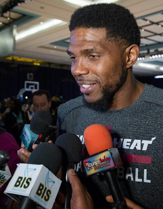 Miami Heat forward Udonis Haslem speaks with reporters after training at the Atlantis resort on Paradise Island, Bahamas, Wednesday, Oct. 2, 2013. The two-time defending NBA champions are holding a on