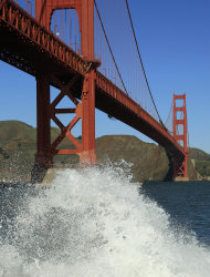 A wave breaks under the Golden Gate Bridge at high tide Thursday, Dec. 13, 2012 in San Francisco. The National Weather Service says so-called King Tides  caused by a rather unique combination of how the sun, the moon and the earth align  will bring the highest tides of the year on Thursday, Friday and Saturday mornings. Along with the high tides, forecasters say a building swell will bring large breaking waves to area beaches. The San Francisco Chronicle reports the combination of high tides and surf has flooded some parking lots in San Francisco and in Marin County. (AP Photo/Ben Margot)