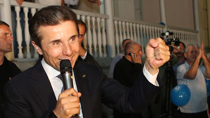 Georgia's billionaire and opposition leader Bidzina Ivanishvili reacts with  supporters at his office in Tbilisi Georgia, Monday, Oct.1, 2012. Georgia's opposition coalition 'Georgian Dream' is leading the country's just-concluded parliamentary elections, according to the exit polls of a U.S.-based exit poll specialist company Edison Research and a Germany-based market research company GfK on Monday. Voters in Georgia are choosing a new parliament in a heated election Monday that will decide the future of President Mikhail Saakashvili's government. (AP Photo/str)