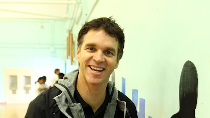 IMAGE DISTRIBUTED FOR AEG - Luc Robitaille, LA Kings President of Business Operations, volunteers at AEG's Season of Giving Day of Service at Bret Harte Prep Middle School, Friday, Nov. 30, 2012 in Los Angeles. (Photo by Matt Sayles/Invision for AEG/AP Images)