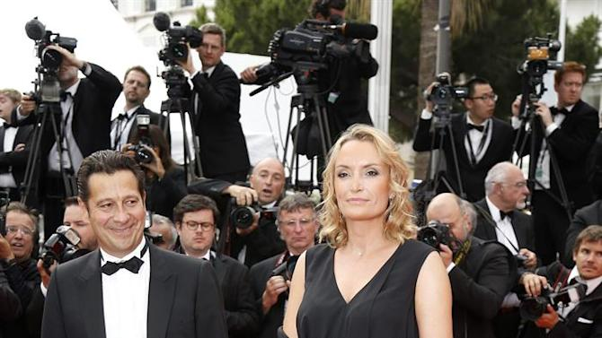 . Cannes (France), 24/05/2015.- French actor Laurent Gerra (L) and partner Christelle Lyon (R) arrive for the screening of 'La Glace et le Ciel' (Ice and the Sky) and the Closing Award Ceremony of the 68th annual Cannes Film Festival, in Cannes, France, 24 May 2015. The festival closes with the screening of the movie presented out of competition. (Cine, Francia) EFE/EPA/SEBASTIEN NOGIER