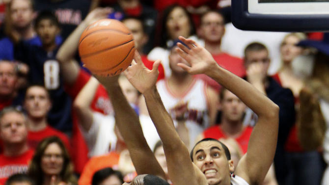 Florida's Michael Frazier II (20) tries to shoot over Arizona's Grant Jerrett(33) during the first half of an NCAA college basketball game at McKale Center in Tucson, Ariz., Saturday, Dec. 15, 2012. (AP Photo/Wily Low)