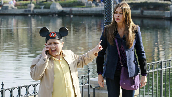 """In this publicity photo released by ABC, Rico Rodriguez, left, and Sofia Vergara are shown in a scene from """"Modern Family."""" The program was nominated for an Emmy award for outstanding comedy series on Thursday, July 19, 2012. The 64th annual Primetime Emmy Awards will be presented Sept. 23 at the Nokia Theatre in Los Angeles, hosted by Jimmy Kimmel and airing live on ABC. (AP Photo/ABC, Peter """"Hopper"""" Stone)"""
