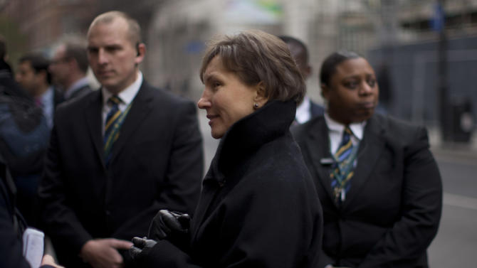 """Marina Litvinenko, center, the widow of former Russian intelligence officer Alexander Litvinenko, is flanked by security workers whilst speaking to a journalist as she leaves at the end of a Pre-Inquest Review at Camden Town Hall in London, Thursday, Dec. 13, 2012.  A lawyer has told a British inquest into the poisoning death of former Russian agent Alexander Litvinenko that an initial assessment of evidence showed that the Russian state was responsible for his murder.  Hugh Davies, the inquest's counsel, told a London hearing that a """"high-level assessment"""" of material provided by the British government """"does establish a case for the Russian state's culpability"""" in the murder of Litvinenko, who died in November 2006 after drinking tea laced with the rare radioactive isotope polonium-210 at a London hotel.  (AP Photo/Matt Dunham)"""