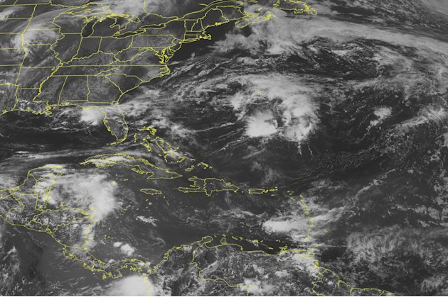 This NOAA satellite image taken Friday, June 15, 2012 at 1:45 PM EDT shows dense cloud cover over the northwestern basin as circulation from a remnant tropical wave sirs up scattered showers and thund
