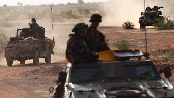 French soldiers patrol in armored vehicles, in the outskirts of Sevare, Mali, some 620 kms (385 miles) north of Bamako, Wednesday, Jan. 23, 2013. The U.S. airlift of French forces to Mali to fight Islamic extremists is expected to go on for another two weeks, Pentagon officials said, as hundreds of African troops from Nigeria, Togo, Burkina Faso and Senegal are now joining the French-led intervention. (AP Photo/Thibault Camus)