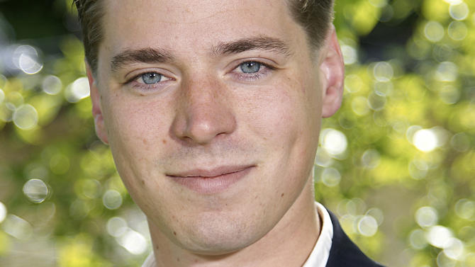 """In this undated photo released by the Moderate Party in Halland county, Swedish politician Hravn Forsne poses for a photograph. A Swedish politician surrounded by rumors of being the secret son of Francois Mitterrand has said in an interview that the late French president is his father. Hravne Forsne, a 25-year-old running for Parliament, told local newspaper Kungsbacka-Nytt """"that's how it is: Francois Mitterrand was my father."""" (AP Photo)"""