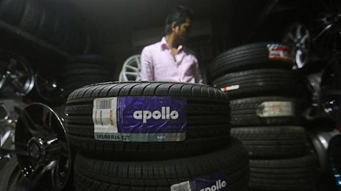 An employee works inside a showroom selling Apollo tyres in Mumbai June 13, 2013. REUTERS/Danish Siddiqui/Files