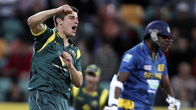 Australia's Moises Henriques (L) celebrates taking the wicket of Thisara Perera (R) of Sri Lanka (Reuters)