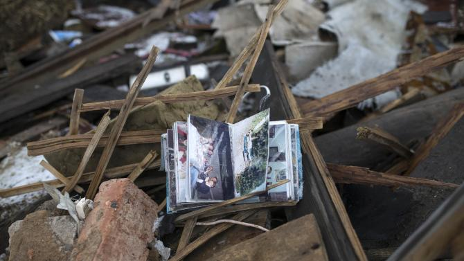 A family photo album is seen in the ruins of a house in a neighborhood near the Donetsk airport