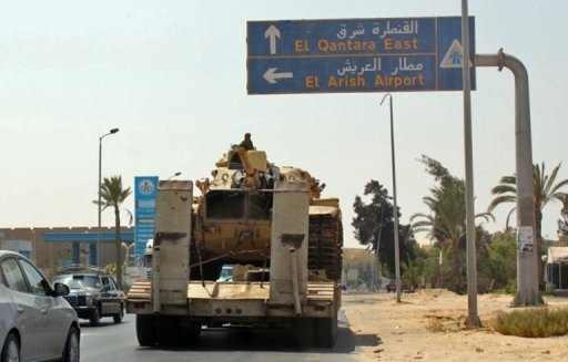 Egyptian tanks are seen being carried on the back of trucks on the Egyptian side of the border city of Rafah on August 29. Israeli Defence Minister Ehud Barak on Thursday said he expected the Egyptian army to withdraw its reinforcements from the Sinai Peninsula at the end of its operation to root out Islamist militants