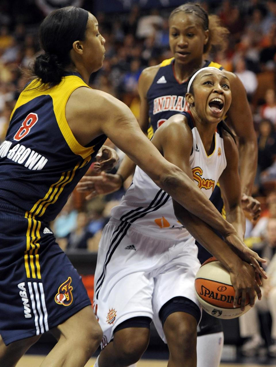 Connecticut Sun's Renee Montgomery, right, is pressured by Indiana Fever's Tammy Sutton-Brown during the first half of Game 1 of the WNBA basketball Eastern Conference Finals in Uncasville, Conn., Friday, Oct. 5, 2012. (AP Photo/Jessica Hill)