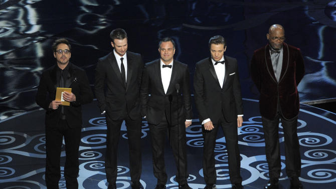From left, actors Robert Downey Jr., Chris Evans, Mark Ruffalo, Jeremy Renner and Samuel L. Jackson present an award onstage during the Oscars at the Dolby Theatre on Sunday Feb. 24, 2013, in Los Angeles.  (Photo by Chris Pizzello/Invision/AP)