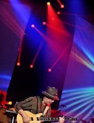 Mexican-American rock guitarist Carlos Santana performs at the annual Java Jazz Festival 2011 in Jakarta. Faced with stubbornly feeble economies back home, more Western music acts are being lured to play in Asia to boost their profiles in a region where disposable incomes are growing
