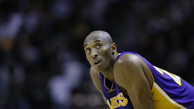Los Angeles Lakers' Kobe Bryant carches his breath during the fourth quarter of an NBA basketball game against the San Antonio Spurs, Wednesday, Jan. 9, 2013, in San Antonio. San Antonio won 108-105. (AP Photo/Eric Gay)