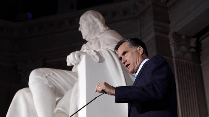 FILE - In this April 16, 2012, file photo, Republican presidential candidate, former Massachusetts Gov. Mitt Romney addresses supporters at a Tax Day Tea Summit held at Franklin Institute in Philadelphia. Under his own tax proposal, Romney would pay half what he would pay in taxes under President Barack Obama's plan. For a man of Romney's means, that could save almost $5 million a year.  (AP Photo/Jae C. Hong, File)