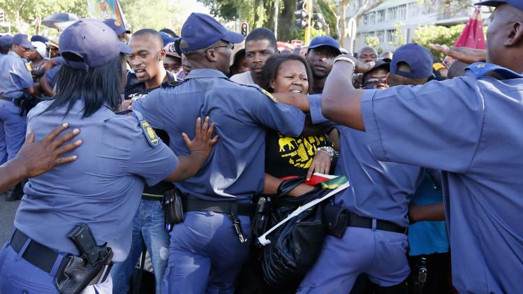 South African police try to block mourners at a checkpoint while they attempt to walk to the Union building to see the body of former South African President Mandela in Pretoria