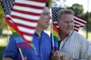 Married couple Bill Hacket and Thom Uber wave flags in West Hollywood