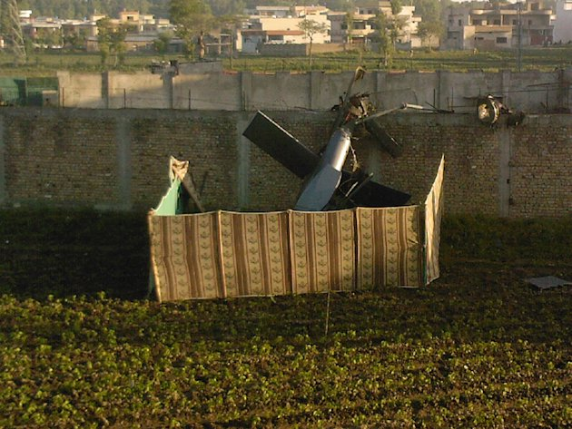 A photo taken by a local resident, shows the wreckage of a helicopter next to the wall of the compound where according to officials, Osama bin Laden wss shot and killed in a firefight with U.S. forces