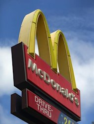 MIAMI, FL - JULY 23: A sign for a McDonald's restaurant is seen July 23, 2012 in Miami, Florida. The company announced that 2nd quarter profit dropped 4.5 percent.   Joe Raedle/Getty Images/AFP