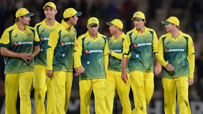 Australia's captain Steven Smith (right) leads his players back to the pavilion after winning the first one-day international against England in Southampton on September 3, 2015