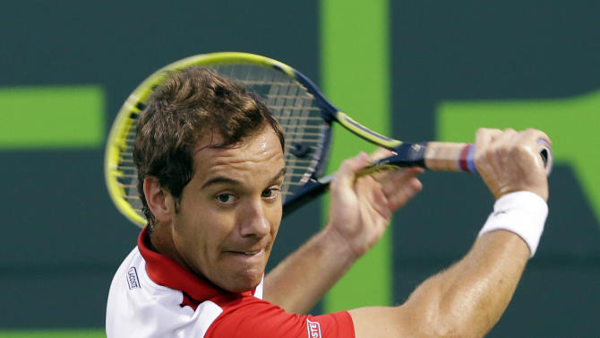Richard Gasquet, of France, returns a shot from Tomas Berdych, of the Czech Republic, during a quarterfinal match at the Sony Open tennis tournament, Thursday, March 28, 2013, in Key Biscayne, Fla. (AP Photo/Wilfredo Lee)