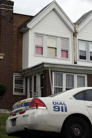 A police car sits in view of a decorated window in the home of a severely disabled 3-year-old girl who was pronounced dead at a nearby hospital, Monday, Sept. 9, 2013, in Philadelphia. Nathalyz Rivera, a twin, weighed just 11 pounds when she died and police in Philadelphia called her death a homicide. Police are searching for the girl's father, Carlos Rivera, after they said he left four other children in a relative's care and fled. (AP Photo/Matt Rourke)