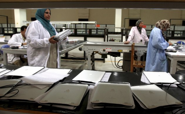 "Workers check Egypt's first tablet computer ""Inar"" at a factory in Benha"