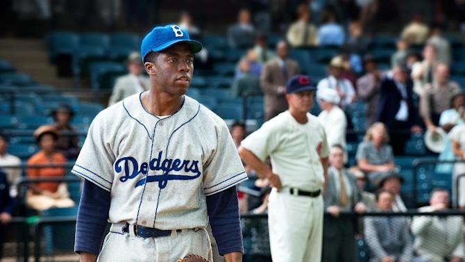 """This film image released by Warner Bros. Pictures shows Chadwick Boseman as Jackie Robinson in a scene from """"42."""" Kansas City's Negro Leagues Baseball Museum is hosting an advance screening of an upcoming movie about Jackie Robinson, who broke major league baseball's color barrier. Thomas Butch of the financial firm Waddell and Reed announced Wednesday, March 20, 2013, that actors Harrison Ford and Andre Holland will be among those appearing at an April 11 screening of """"42.""""  The film chronicles Robinson's rise from the Negro Leagues' Kansas City Monarchs in 1945 to the Brooklyn Dodgers in 1947, when he won the inaugural Rookie of the Year award. The film opens nationwide on April 12. (AP Photo/Warner Bros. Pictures, D. Stevens)"""