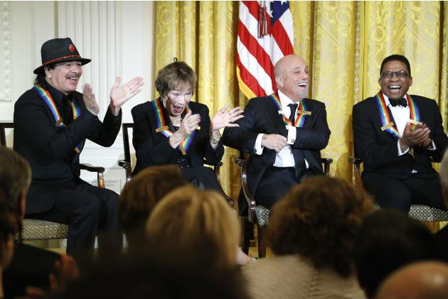 Santana and fellow 2013 Kennedy Center Honors recipients MacLaine, Joel and Hancock laugh at a joke by U.S. President Obama during a reception at the White House in Washington