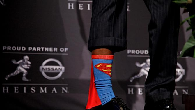 Heisman Trophy winner Robert Griffin III, of Baylor, shows off his Superman socks during a news conference after the ceremony, Saturday, Dec. 10, 2011, in New York. The junior quarterback known as RG3 became the first Heisman winner from Baylor. (AP Photo/Craig Ruttle)