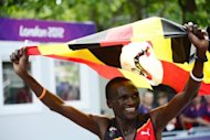 Uganda&#39;s Stephen Kiprotich waves his national flag as he celebrates winning the Olympic marathon in London on August 12. Kiprotich stunned a strong Kenyan team to win the men&#39;s Olympic marathon on Sunday, handing his east African nation only their second ever gold medal