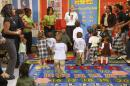 "FILE - In this Tuesday, Nov. 1, 2011 file photo, first lady Michelle Obama sings and dances to exercises with staff, parents and children as she visits the Royal Castle Child Development Center, as part of the ""Lets Move!"" initiative in New Orleans, La. In 18 states, there were at least slight drops in obesity for low-income preschoolers, health officials said Tuesday, Aug. 6, 2013. Childhood obesity has been a focus of the Obama White House, with the first lady leading a campaign called ""Let's Move!"" Sam Kass, the program's chief administrator, said thousands of preschools and day care centers across the country have pledged to increase physical playtime and serve healthier foods. (AP Photo/Gerald Herbert)"